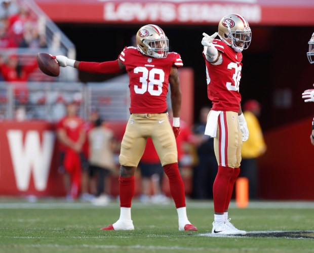 San Francisco 49ers' Dontae Johnson (36) celebrates a fumble recovery by San Francisco 49ers' Adrian Colbert (38) against the Tennessee Titans in the second quarter of their NFL game at Levi's Stadium in Santa Clara, Calif., on Sunday, Dec. 17, 2017. (Nhat V. Meyer/Bay Area News Group)