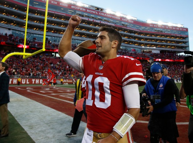 San Francisco 49ers starting quarterback Jimmy Garoppolo (10) pumps his fist following their 25-23 win against the Tennessee Titans for their NFL game at Levi's Stadium in Santa Clara, Calif., on Sunday, Dec. 17, 2017. (Nhat V. Meyer/Bay Area News Group)