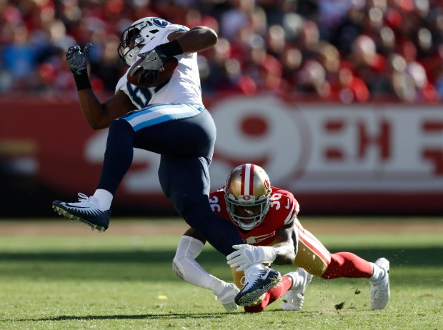 San Francisco 49ers' Dontae Johnson (36) tackles Tennessee Titans' Jonnu Smith (81) after a catch in the first quarter of their NFL game at Levi's Stadium in Santa Clara, Calif., on Sunday, Dec. 17, 2017. (Nhat V. Meyer/Bay Area News Group)