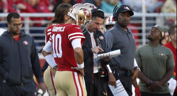 San Francisco 49ers starting quarterback Jimmy Garoppolo (10) talks to San Francisco 49ers head coach Kyle Shanahan during a time-out during their game against the Tennessee Titans in the second quarter of their NFL game at Levi's Stadium in Santa Clara, Calif., on Sunday, Dec. 17, 2017. (Nhat V. Meyer/Bay Area News Group)