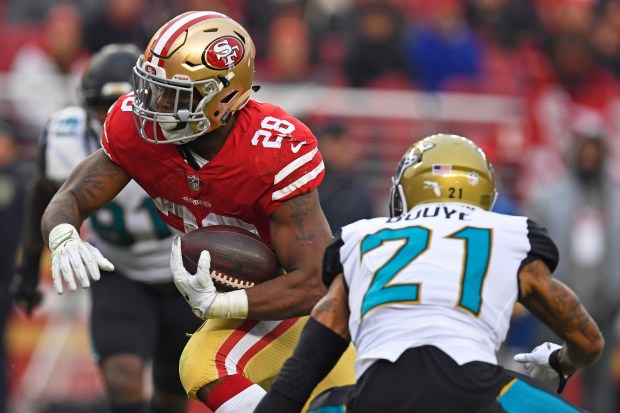 San Francisco 49ers' Carlos Hyde (28) runs past Jacksonville Jaguars' A.J. Bouye (21) to score a touchdown during the fourth quarter of their NFL game at Levi's Stadium in Santa Clara, Calif., on Sunday, Dec. 24, 2017. San Francisco defeated Jacksonville 44-33. (Jose Carlos Fajardo/Bay Area News Group)