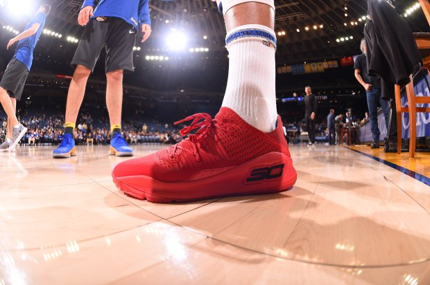 "Stephen Curry of the Golden State Warriors unveiled his new Under Armourshoe during a workout Wednesday night. For each pair sold, Curry will donate a malaria-prevention net as part of his ""Nothing But Nets"" campaign. (Photo credit: Golden State Warriors)"