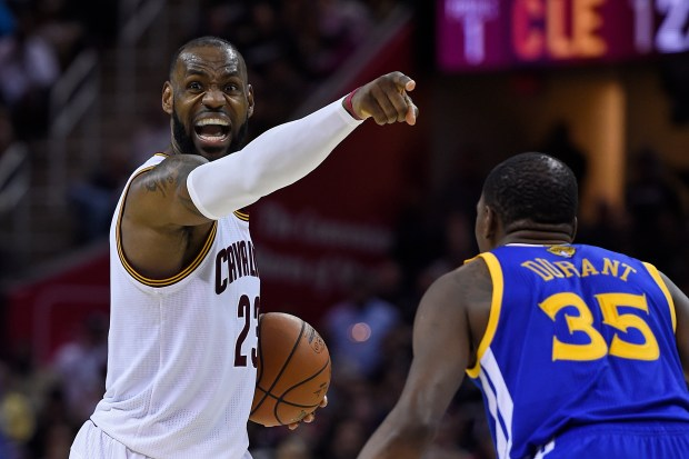 a34fb2f02cf Cleveland Cavaliers  LeBron James (23) gestures while being guarded by Golden  State Warriors