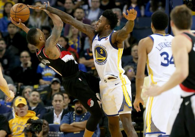 Golden State Warriors' Jordan Bell (2) fouls Portland Trail Blazers' Al-Farouq Aminu (8) in the fourth quarter of their NBA game at Oracle Arena in Oakland, Calif., on Monday, Dec. 11, 2017. (Jane Tyska/Bay Area News Group)