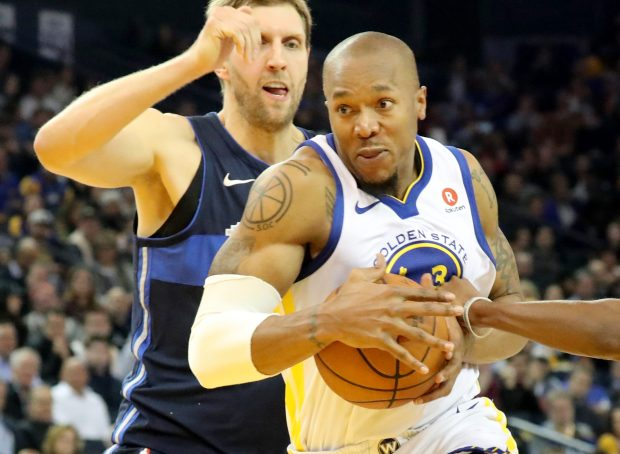 Golden State Warriors' David West (3) drives past Dallas Mavericks' Dirk Nowitzki (41) in the first half at Oracle Arena in Oakland, Calif., on Thursday, Dec. 14, 2017. (Ray Chavez/Bay Area News Group)