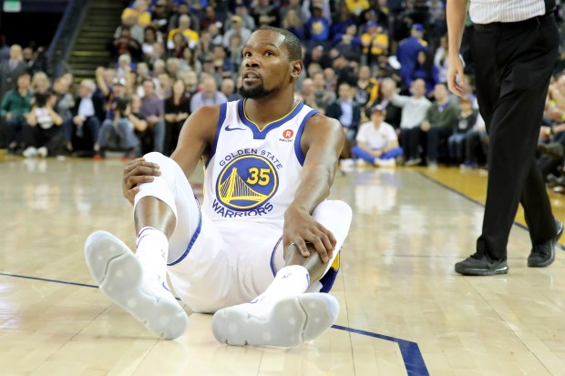 Golden State Warriors' Kevin Durant (35) ends up on the floor he was fouled by the Dallas Mavericks in the first half at Oracle Arena in Oakland, Calif., on Thursday, Dec. 14, 2017. (Ray Chavez/Bay Area News Group)