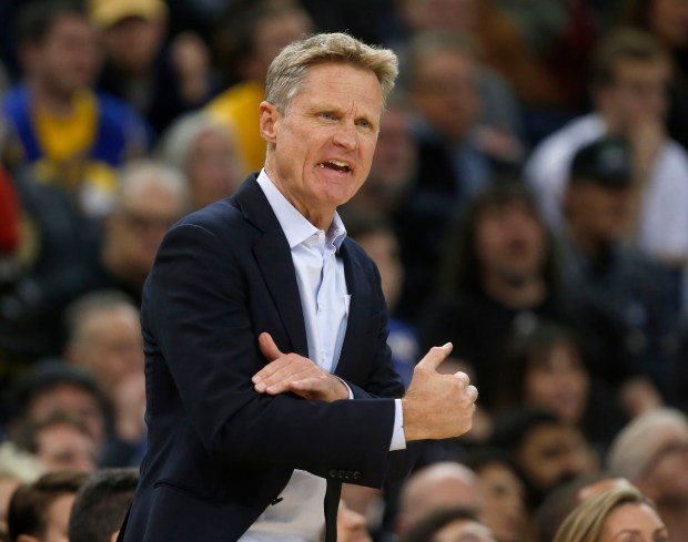 Golden State Warriors head coach Steve Kerr talks to a player during their game against the Memphis Grizzlies in the fourth quarter at Oracle Arena in Oakland, Calif., on Wednesday, Dec. 20, 2017. (Nhat V. Meyer/Bay Area News Group)