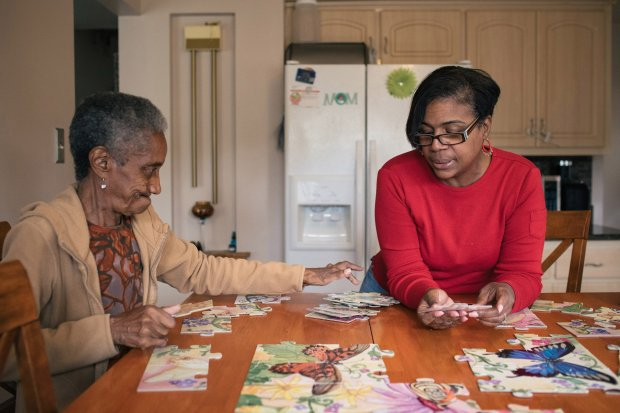 Alantris Muhammad said she found puzzles a helpful brain and dexterityexercise for her mom. MUST CREDIT: photo for The Washington Post by Alyssa Schukar.