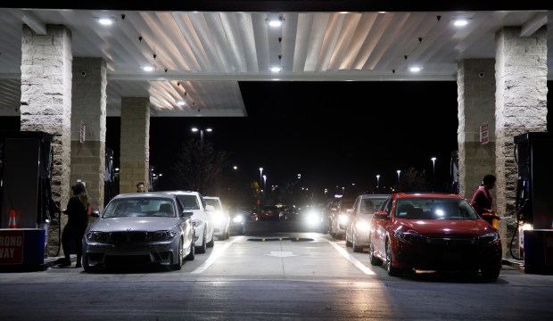 Motorists fill up their gas tanks at a gas station in Fremont, on Dec. 19, 2017. A petition is circulating to repeal the newly enacted 12-cent increase in the gas tax, while at the same time Bay Area officials are considering up to a $3 toll hike for most bridges spanning the Bay Area. (Dai Sugano/Bay Area News Group)