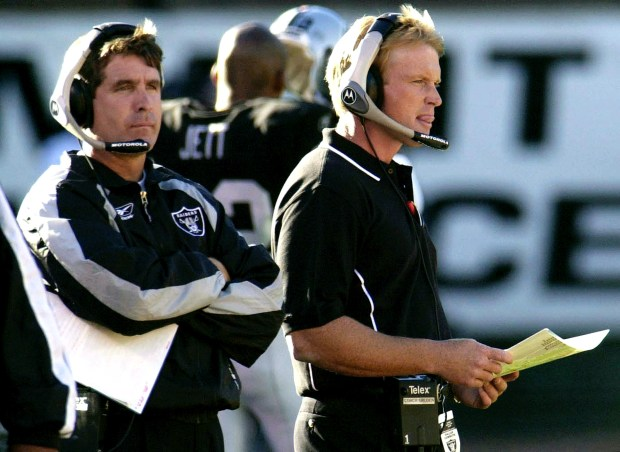 ** ADVANCE FOR WEEKEND EDITIONS JAN. 4-5 ** Former Oakland Raiders head coach Jon Gruden, right, stands with current coach Bill Callahan against the Dallas Cowboys Aug. 4, 2001, in Oakland, Calif. Callahan has never said he's anything like his predecessor, the exuberant Jon Gruden. They're about as different as they come, but that hasn't mattered one bit. (AP Photo/Oakland Tribune, Ron Lewis)