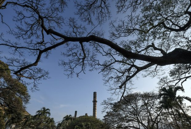 A smokestack towers above the grounds of Hawaiian Commercial & Sugar inPuunene, Hawaii, in May. The mill ceased production in December 2016. MUST CREDIT: Washington Post photo by Bonnie Jo Mount