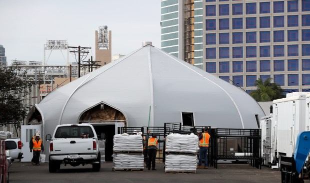 In this Nov. 28, 2017, photo, a tent to house the homeless is seen in downtown San Diego. An unprecedented increase in people living on the streets is rocking cities along the West Coast from Washington to California. Facing an acute shortage of housing for the poor, San Diego is turning to tents to get people off the streets for now. The city diverted $6.5 million from its permanent housing budget to operate the giant tents. (AP Photo/Gregory Bull)