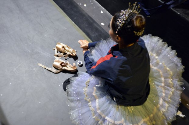 Seo Hye Han massages her feet backstage. MUST CREDIT: Photo for TheWashington Post by Josh Reynolds