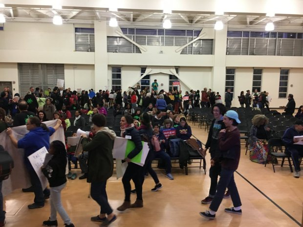 Students, parents and teachers packed the auditorium of La EscuelitaElementary School on Wednesday, Dec. 13, to oppose the Oakland Unified school board's decision to cut $9 million from the 2017-2018 budget mid year. (Ali Tadayon/Staff)