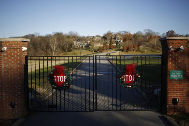 An entrance to the Rivergreen gated community in Bowling Green, Ky. MUSTCREDIT: Photo by Luke Sharrett for The Washington Post