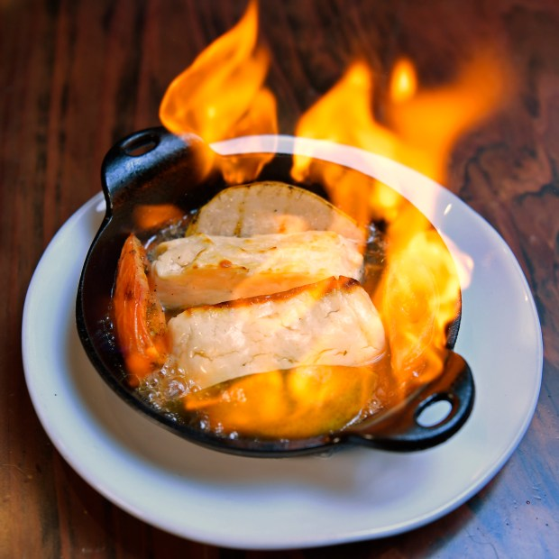 A plate of flaming Hellumi cheese is photographed at Lokanta Mediterranean Grill & Bar in Walnut Creek, Calif. on Thursday, Dec. 7, 2017. (Jose Carlos Fajardo/Bay Area News Group)