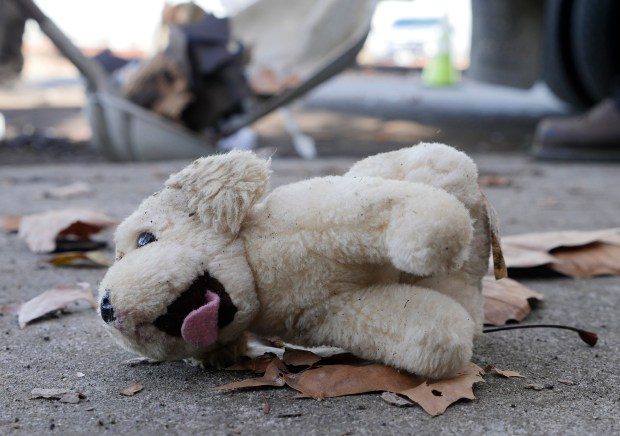 A discarded stuffed animal is one of the many items found in a heap of trash illegally dumped along Chynoweth Avenue on Thursday, Nov. 30, 2017, in San Jose, Calif. (Jim Gensheimer/Bay Area News Group)