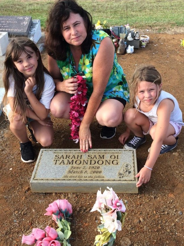The author's daughter, Madeline Crum, wife Megan Crum and daughter Lily Crum at the grave of Megan's paternal grandmother in Naalehu, Hawaii. (Courtesy: Rex Crum)