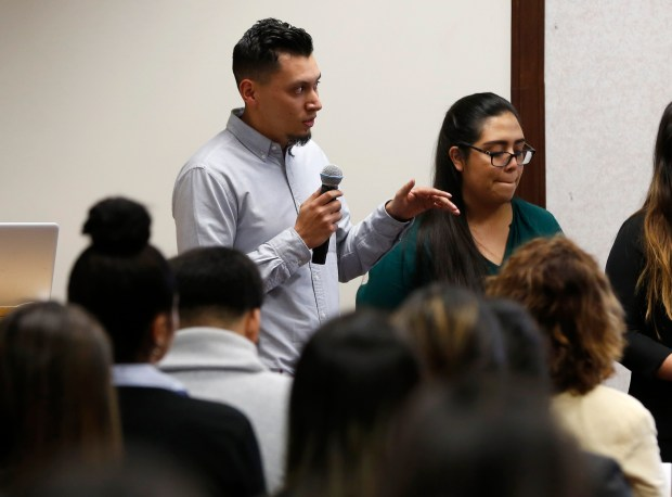 """Juan Rocha, left, a senior at San Jose State University, speaks during a presentation with his group for Braven in the engineering building at SJSU in San Jose, Calif., on Tuesday, Dec. 5, 2017. Braven is a nonprofit organization trying to reimagine how college students who don't come from wealthy, well-connected families get valuable career advice by pairing them with """"coaches."""" (Nhat V. Meyer/Bay Area News Group)"""