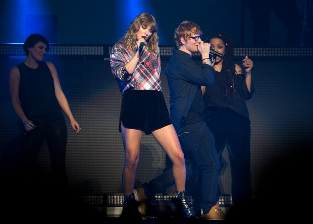 Taylor Swift, center left, performs with Ed Sheehan, center right, at the Poptopia Holiday concert presented by 99.7 Now! at the SAP center in downtown San Jose, California on Saturday, December 2, 2017. (LiPo Ching/Bay Area News Group)