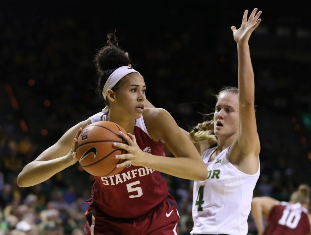 Stanford forward Kaylee Johnson, left, pulls down a rebound next to Baylor guard Kristy Wallace during the first half of an NCAA college basketball game, Sunday, Dec. 3, 2017, in Waco, Texas. (Rod Aydelotte/Waco Tribune Herald, via AP)