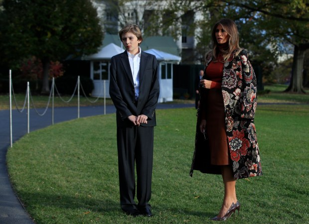 First lady Melania Trump and Barron Trump, wait for President Donald Trump, speaking to reporters on the South Lawn as they leave the White House, Tuesday, Nov. 21, 2017, in Washington for a Thanksgiving trip to his Mar-a-Lago estate in Palm Beach, Fla.. (AP Photo/Manuel Balce Ceneta)