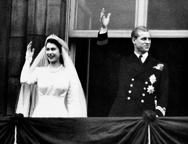 Princess Elizabeth and Prince Philip, Duke of Edinburgh make a charming picture as they wave to the crowds from the balcony of Buckingham Palace in London on November 20,1947, their wedding day. (AP Photo)