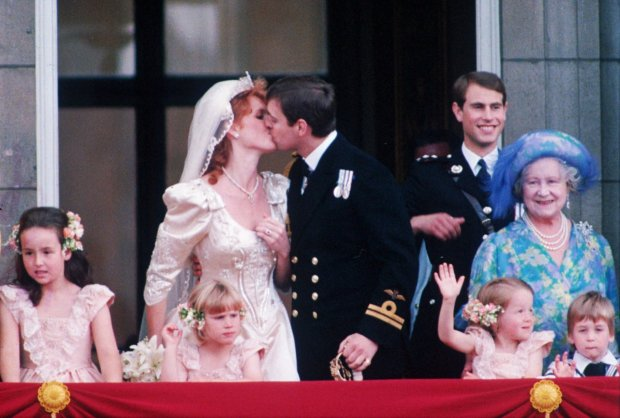 Prince Andrew kisses his bride Sarah Ferguson on the balcony of Buckingham Palace following the wedding at Westminister Abbey on July 23, 1986. The Queen Mother and Prince Edward stand to the right. Others unidentified. (AP Photo)