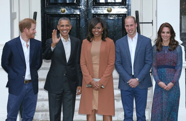 Britain's Prince Harry, left, stands with the Duke and Duchess of Cambridge, right, outside of Kensington Palace in London, with United States President Barack Obama and his wife Michelle, prior to a private dinner, Friday April 22, 2016. Obama stepped into Britain's debate about EU membership and many other topics, as he starts a three day visit to Britain. (Chris Radburn/Pool via AP)