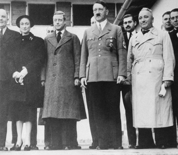 The Duke and Duchess of Windsor, left, are shown as they visited Adolf Hitler at his home in Berchtesgaden, Germany, on their tour of that country, Oct. 1937. On Hitler's right is Dr. Robert Ley, head of the German Labor Front, and guide of the Windsors on many of their industrial visits. (AP Photo)