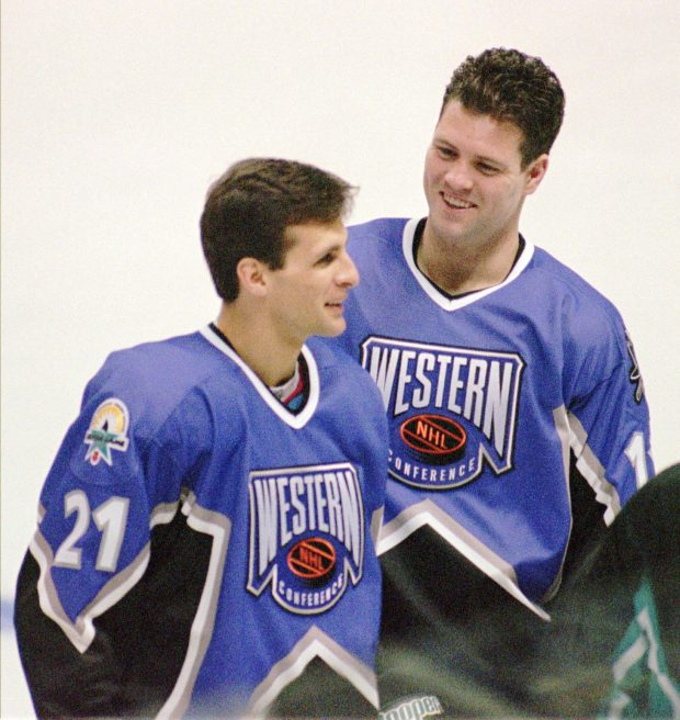 San Jose Sharks left wing Tony Granato, left, and right wing Owen Nolan smile during West practice, Friday morning, Jan. 17, 1997, at the San Jose, Calif., Arena, before the All-Star game on Saturday night. (AP Photo/Stephen J. Pringle)