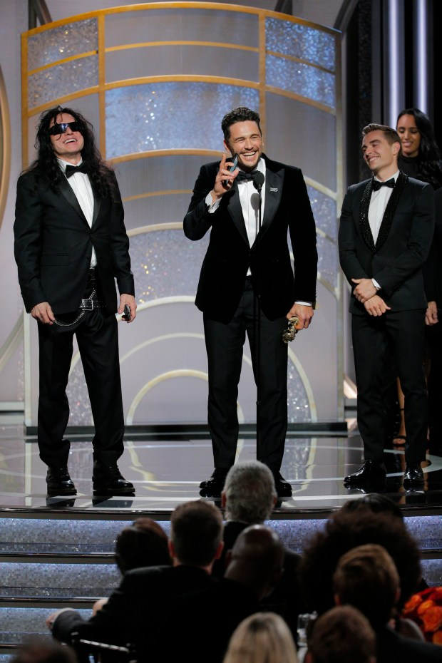 BEVERLY HILLS, CA - JANUARY 07: In this handout photo provided by NBCUniversal, James Franco, with Tommy Wiseau and Dave Franco, accepts the award for Best Performance by an Actor in a Motion Picture Musical or Comedy for The Disaster Artist during the 75th Annual Golden Globe Awards at The Beverly Hilton Hotel on January 7, 2018 in Beverly Hills, California. (Photo by Paul Drinkwater/NBCUniversal via Getty Images)