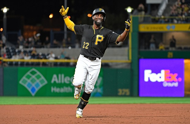 Andrew McCutchen #22 of the Pittsburgh Pirates reacts as he rounds the bases after hitting a grand slam home run in the second inning during the game against the Baltimore Orioles at PNC Park on September 26, 2017 in Pittsburgh, Pennsylvania. The grand slam home run was the first of McCutchen's career. (Photo by Justin Berl/Getty Images)
