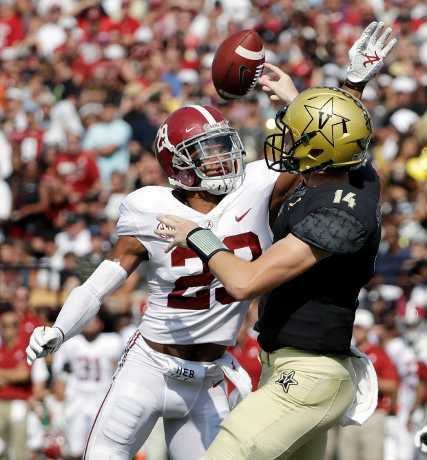 File- This Sept. 23, 2017, file photo shows Alabama defensive back Minkah Fitzpatrick (29) hitting the arm of Vanderbilt quarterback Kyle Shurmur (14) to cause an incomplete pass in the first half of an NCAA college football game in Nashville, Tenn. Fitzpatrick was selected to the AP All-America team announced Monday, Dec. 11, 2017. (AP Photo/Mark Humphrey, File)