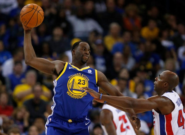 Golden State Warriors' Draymond Green (23) looks to pass against Detroit Pistons' Anthony Tolliver (43) in the fourth quarter at Oracle Arena in Oakland, Calif. on Sunday, Oct. 29, 2017. (Nhat V. Meyer/Bay Area News Group)