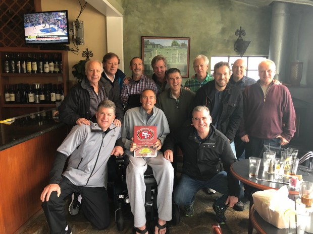 49ers legend Dwight Clark posing with media members,from left (standing) are Lowell Cohn, Mark Purdy, Matt Maiocco, Sam Farmer, Daniel Brown, Scott Ostler, Paul McCaffrey, Kirk Reynolds and Fred Formosa. Kneeling next to Clark are John Faylor (left) and Brian Murphy.