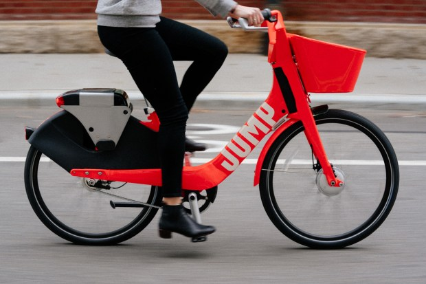 A JUMP Bike user takes a spin on one of the company's electric bikes. (Courtesy JUMP Bike)