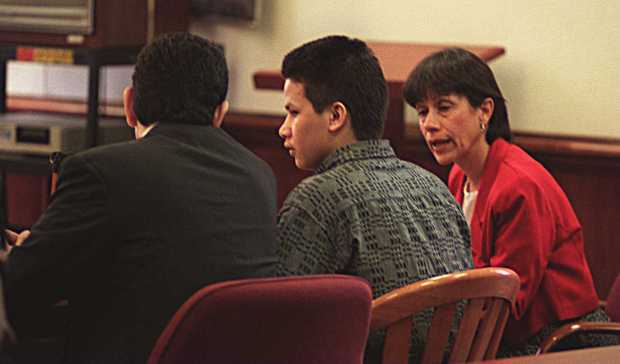 Juan Miguel Chavez-Garcia sits between public defender Roberto Najera and interpreter Maria Munoz as his trial began Tuesday morning May 30, 1995 in Dept. 5 Contra Costa Superior Court in Martinez, CA. Chavez-Garcia is charged with the rape and murder of 15 year old Cecilia Rios in San Pablo, CA.(Jon McNally/Contra Costa Times)1995