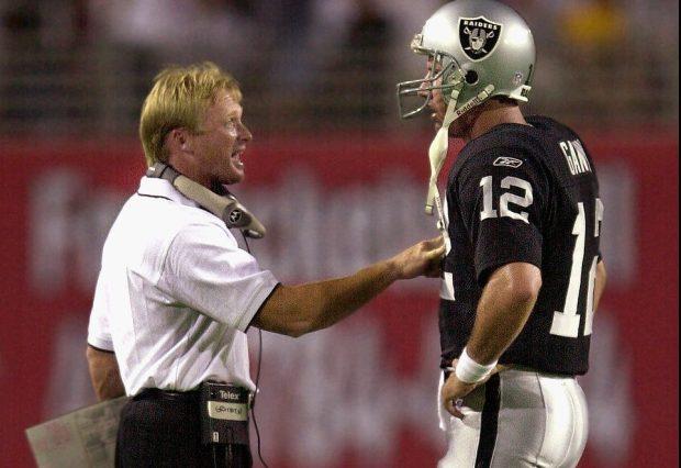 652f9bf13b7 Oakland Raiders head coach Jon Gruden talks with quarterback Rich Gannon  during the first quarter of