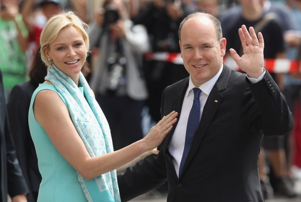 BERLIN, GERMANY - JULY 09: Prince Albert II and Princess Charlene of Monaco wave to onlookers while visiting the Brandenburg Gate on July 9, 2012 in Berlin, Germany. Prince Albert II and Princess Charlene are visiting Berlin and tomorrow will continue to Stuttgart. (Photo by Sean Gallup/Getty Images)
