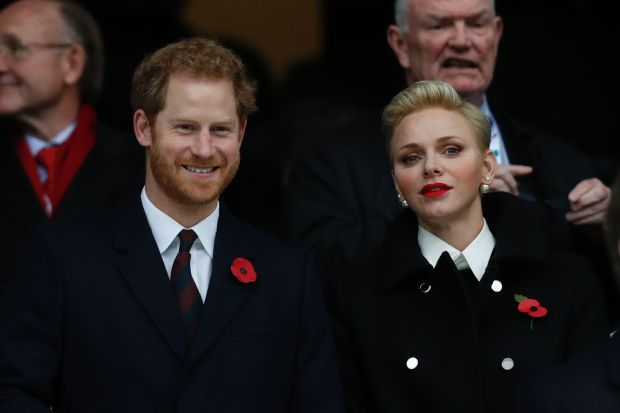 Britain's Prince Harry (L) stands by Princess Charlene of Monaco before the rugby union test match between England and South Africa at Twickenham stadium in southwest London on November 12, 2016. / AFP / Adrian DENNIS (Photo credit should read ADRIAN DENNIS/AFP/Getty Images)