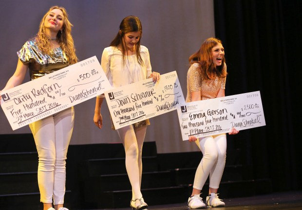 South Bay Teen Idol winners Caity Refern, left, Devon Schreiner and Emma Gerson hold up their prize- winning checks after the 2017 competitions final results were announced. Live auditions for the 2018 Teen Idol are Sunday. (George Sakkestad/Staff Photographer)