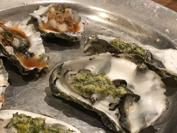 *A classic mignonette and a chipotle-spiked topping adorn fresh oysters.(Courtesy of Jessica Tunis)*