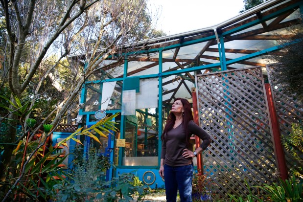 Michele Raffin stands in front one of the many aviaries at Pandemonium Aviaries in Los Altos Hills, California, on Friday, Jan. 12, 2018. Ruffin began the bird refuge in her backyard twenty years ago. Since 2009, she has focused on endangered bird conservation. (Gary Reyes/ Bay Area News Group)