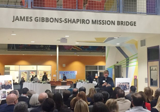 Downtown College Prep Executive Director Jennifer Andaluz speaks to thecrowd at the dedication of the James Gibbons-Shapiro Mission Bridge at the San Jose campus.