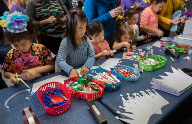 Kids make paper crowns at the Children's Discovery Museum in San Jose, California, Saturday, Jan. 6, 2018. The museum hosted a celebration in honor of El Dia de los Tres Reyes Magos, or The Three Kings. (Patrick Tehan/Bay Area News Group)