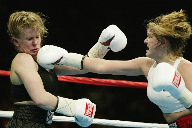 MEMPHIS, TN - FEBRUARY 22: Tonya Harding is hit by a right jab from Samantha Browning during their women's bantamweight bout at The Pyramid on February 22, 2003 in Memphis, Tennessee. Browning won the fight by way of decision after 4 rounds. (Photo by Al Bello/Getty Images)