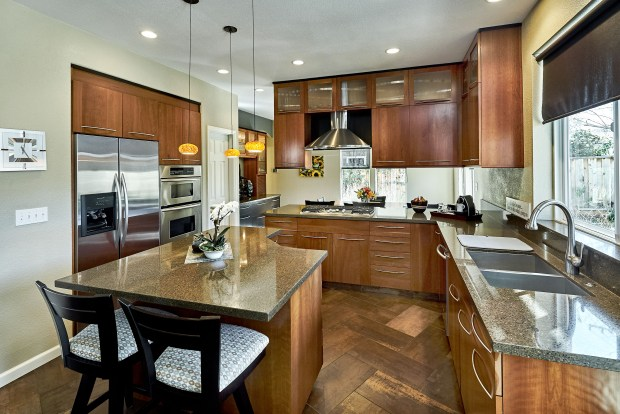 A 2007 remodel created a lovely eat-in kitchen featuring quartz counters and a breakfast bar.