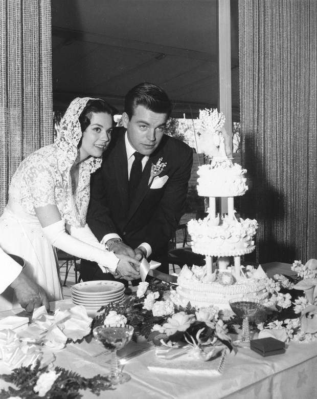Actress Natalie Wood and actor Robert Wagner cut their wedding cake after their marriage in Scotsdale, Ariz., on Dec. 28, 1957. (AP Photo)