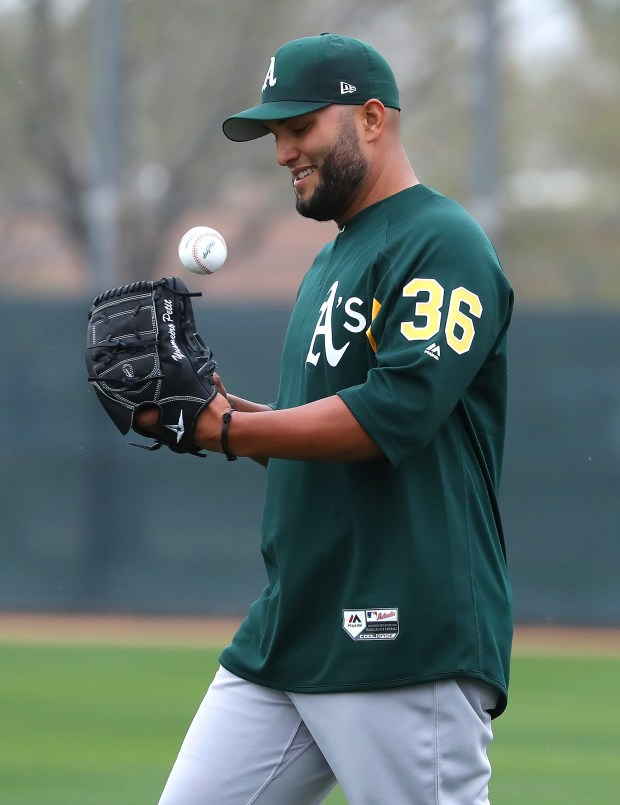 Oakland Athletics pitcher Yusmeiro Petit takes part in a drill at the Lew Wolff Training Complex on the first day of the A's Spring Training workouts on Wednesday, Feb. 14, 2018, in Mesa, AZ. (Aric Crabb/Bay Area News Group)